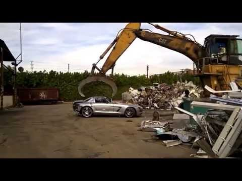 Mercedes SLS AMG being completely destroyed in a scrap yard.